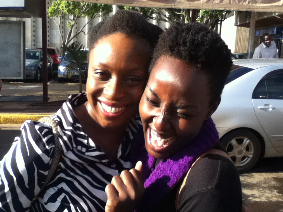 That's celebrated Nigerian author, Chimamanda Ngozi Adichie (with hands conveniently out of view) tickling ordinary little me.