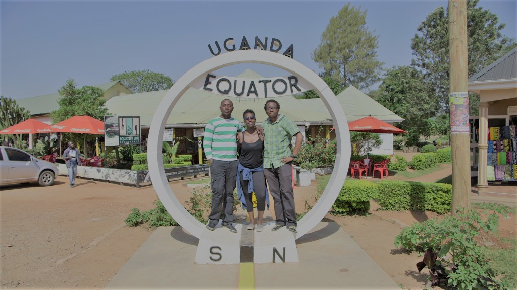With Richard (left) and Moses (right) at the equator line in Kayabwe, Uganda during the March 2017 Jalada Festival.